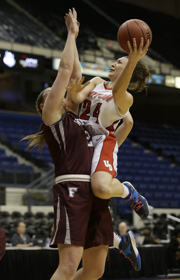 Photo - Dayton guard Andrea Hoover, right, shoots over Fordham forward Samantha Clark during the second half of the A10 women's basketball championship game in Richmond, Va., Sunday, March 9, 2014. Fordham defeated Dayton 63-51. (AP Photo/Steve Helber)