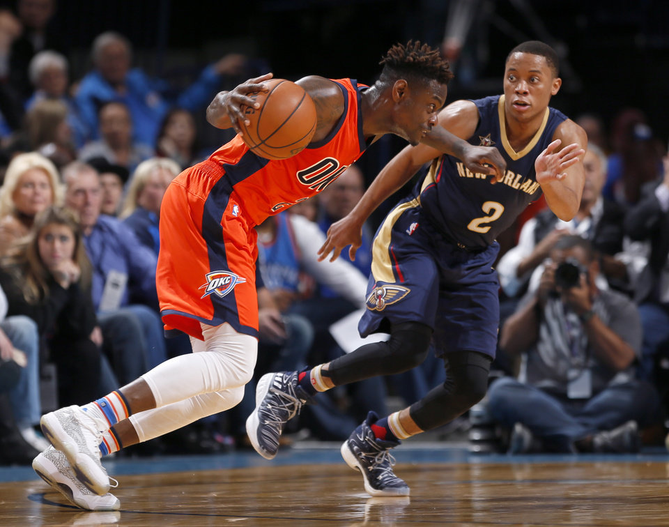 Photo - Oklahoma City's Anthony Morrow (2) drives to the basket as New Orleans' Tim Frazier (2) defends during the NBA game between the Oklahoma City Thunder and the New Orleans Pelicans at the Chesapeake Energy Arena,  Sunday, Dec. 4, 2016. Photo by Sarah Phipps, The Oklahoman