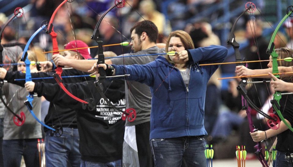 Photo - Ashley Nadeau, 16, from Earlsboro Schools, takes aim during the Oklahoma's National Archery in the Schools Program State Shoot in the Travel and Transportation Building at the State Fair Park, Wednesday, March 27, 2013. Photo By David McDaniel/The Oklahoman