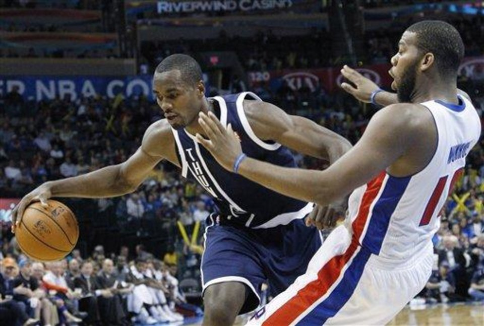Oklahoma City Thunder forward Serge Ibaka (9) drives around Detroit Pistons center Greg Monroe (10) and fouls him in the third quarter of an NBA basketball game in Oklahoma City, Friday, Nov. 9, 2012. Oklahoma City won 105-94. (AP Photo/Sue Ogrocki)