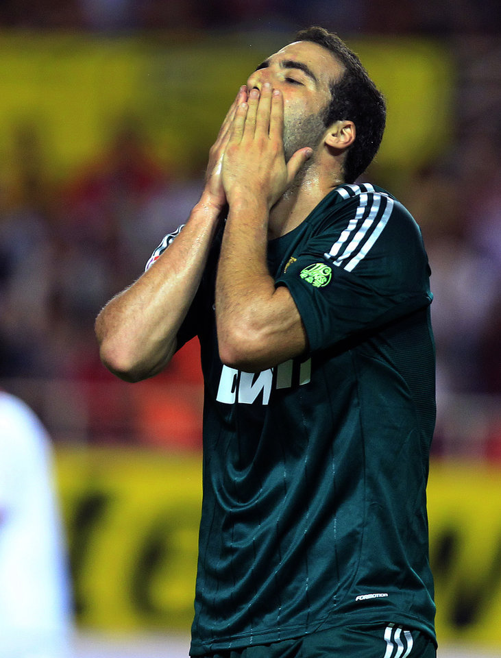 Photo -   Real Madrid's Gonzalo Higuain from Argentina reacts against Sevilla during their La Liga soccer match at the Ramon Sanchez Pizjuan stadium, in Seville, Spain on Saturday, Sept. 15, 2012. (AP Photo/Angel Fernandez)