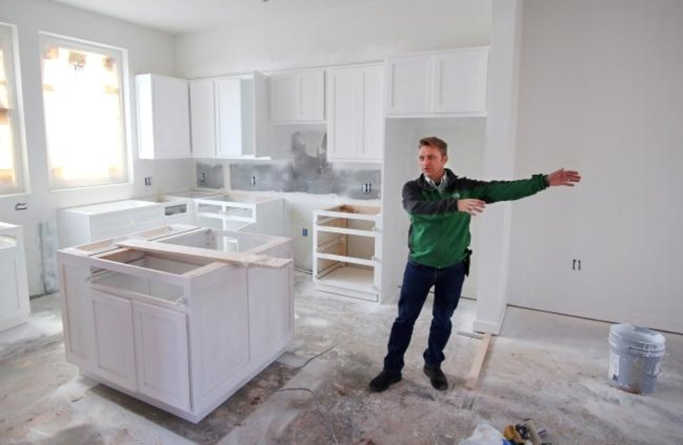 Photo -  Richard McKown talks about a townhome. [Doug Hoke/The Oklahoman]