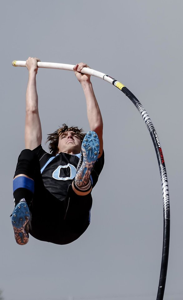 Photo - Okeene's Mikey Dobrinski competes in the Class A pole vault during the Class A and 2A state championship track meet at Carl Albert High School on Friday, May 3, 2013, in Midwest City, Okla. Photo by Chris Landsberger, The Oklahoman
