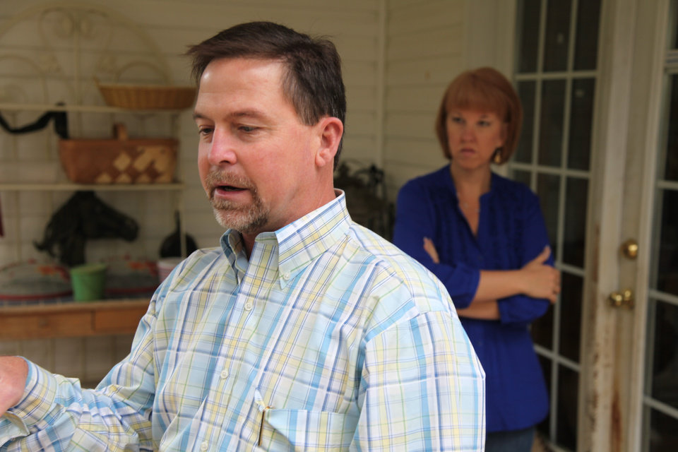 Photo -   In this Oct. 19, 2012, photo, Ray Arvin, front, and his wife, Candice talk to an Associated Press reporter inside their their home in Charlotte, N.C. Romney supporter, Arvin used to own a small business with five employees, selling equipment to power companies, but he went out of business in 2009. He's now a salesman for another equipment company. Polls consistently find that the economy is the top concern of voters, and Romney tends to get an edge over Obama when people are asked who might do better with it. Whether that truly drives how Americans vote is a crucial question for Election Day. (AP Photo/Robert Ray)