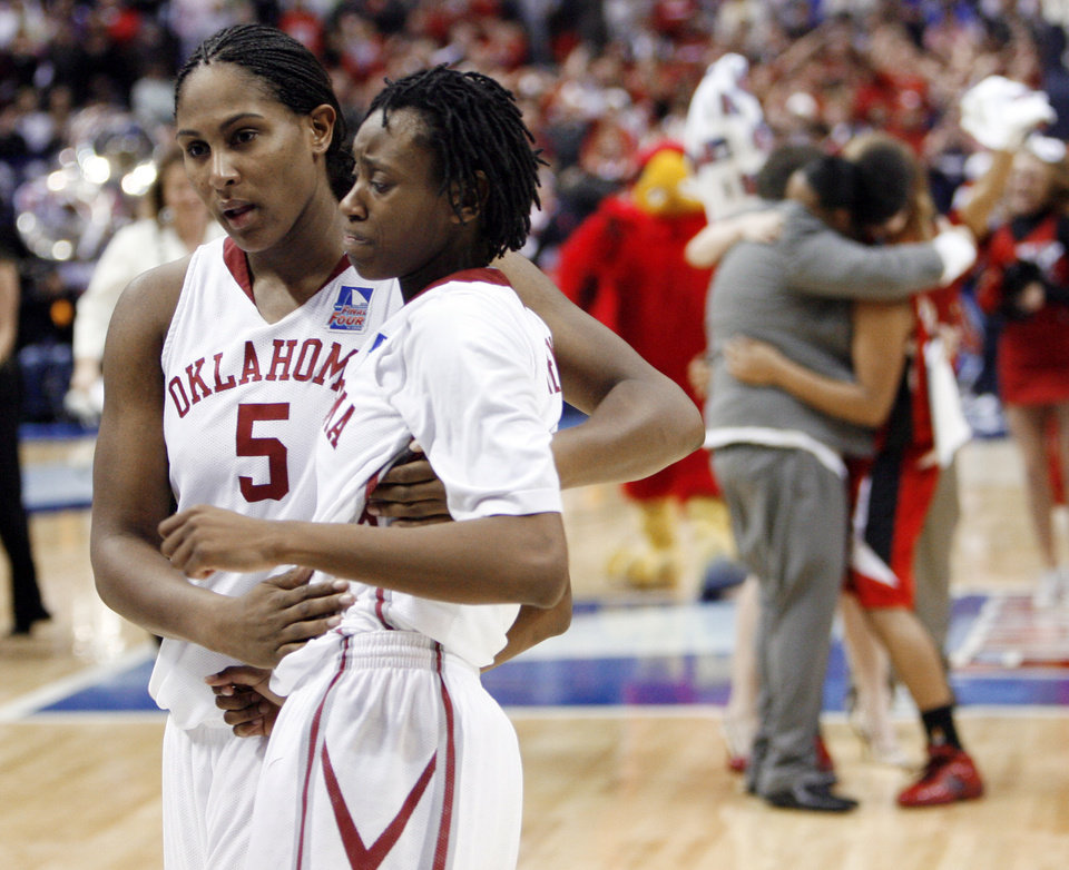 Photo - Sooner Ashley Paris comforts Nyeshia Stevenson after her last second shot misses and the University of Oklahoma is defeated by Louisville 61-59 at the 2009 NCAA women's basketball tournament Final Four in the Scottrade Center in Saint Louis, Missouri on Sunday, April 5, 2009. Photo by Steve Sisney, The Oklahoman