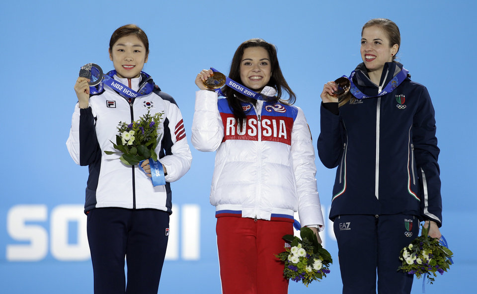 Photo - Women's free skate figure skating medalists, from left, South Korea's Yuna Kim, silver, Russia's Adelina Sotnikova, gold, and Italy's Carolina Kostner, bronze, pose with their medals at the 2014 Winter Olympics in Sochi, Russia, Friday, Feb. 21, 2014.  (AP Photo/David Goldman)