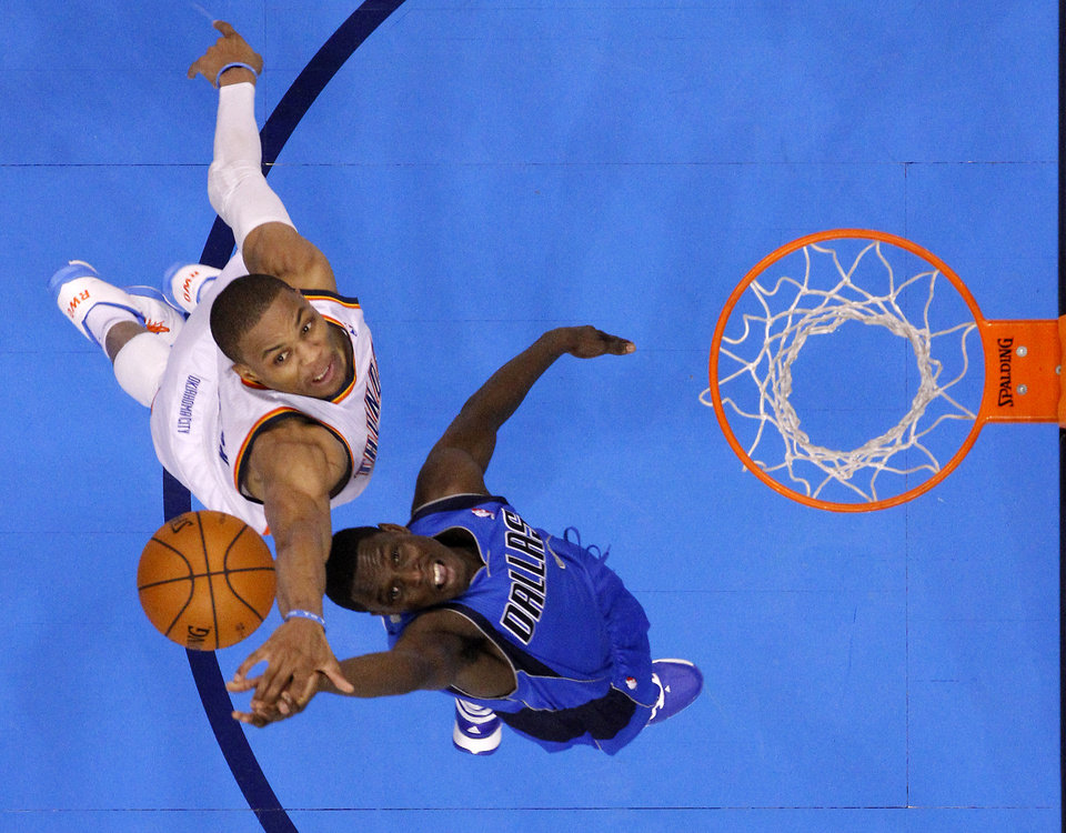 Photo - Oklahoma City's Russell Westbrook (0) defends Dallas' Darren Collison (4) during an NBA basketball game between the Oklahoma City Thunder and the Dallas Mavericks at Chesapeake Energy Arena in Oklahoma City, Thursday, Dec. 27, 2012.  Oklahoma City won 111-105. Photo by Bryan Terry, The Oklahoman