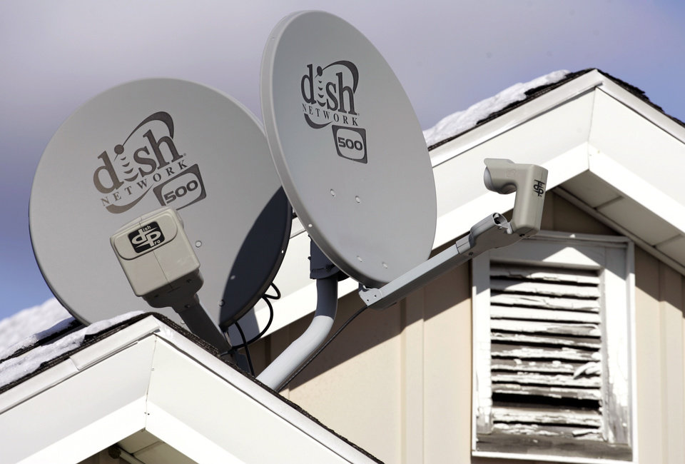 Dish Network Corp. satellite dishes are attached to a home in Buffalo, N.Y.  AP File Photo  <strong>David Duprey -  AP </strong>