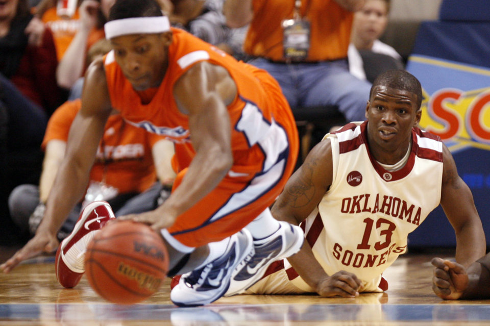 Photo - Oklahoma's Willie Warren (13) looks on as UTEP's Christian Polk (41) recovers a loose ball during the second half of the college basketball game between the University of Oklahoma (OU) and the University of Texas El Paso (UTEP) in the All College Basketball Classic at the Ford Center on Monday, Dec. 21, 2009, in Oklahoma City, Okla.   Photo by Chris Landsberger, The Oklahoman ORG XMIT: KOD
