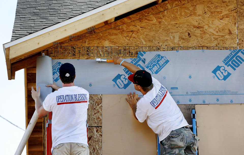 Photo - A  volunteer nonprofit organization from Virginia called Operation Blessing is rebuilding this home at 113 SW 8 in Moore. It was destroyed in the May 20 tornado. PHOTO BY JIM BECKEL, THE OKLAHOMAN  Jim Beckel - THE OKLAHOMAN