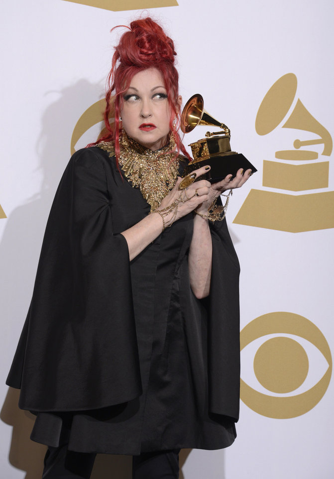 """Photo - Cyndi Lauper poses in the press room with the award for best musical theater album for """"Kinky Boots"""" at the 56th annual Grammy Awards at Staples Center on Sunday, Jan. 26, 2014, in Los Angeles. (Photo by Dan Steinberg/Invision/AP)"""
