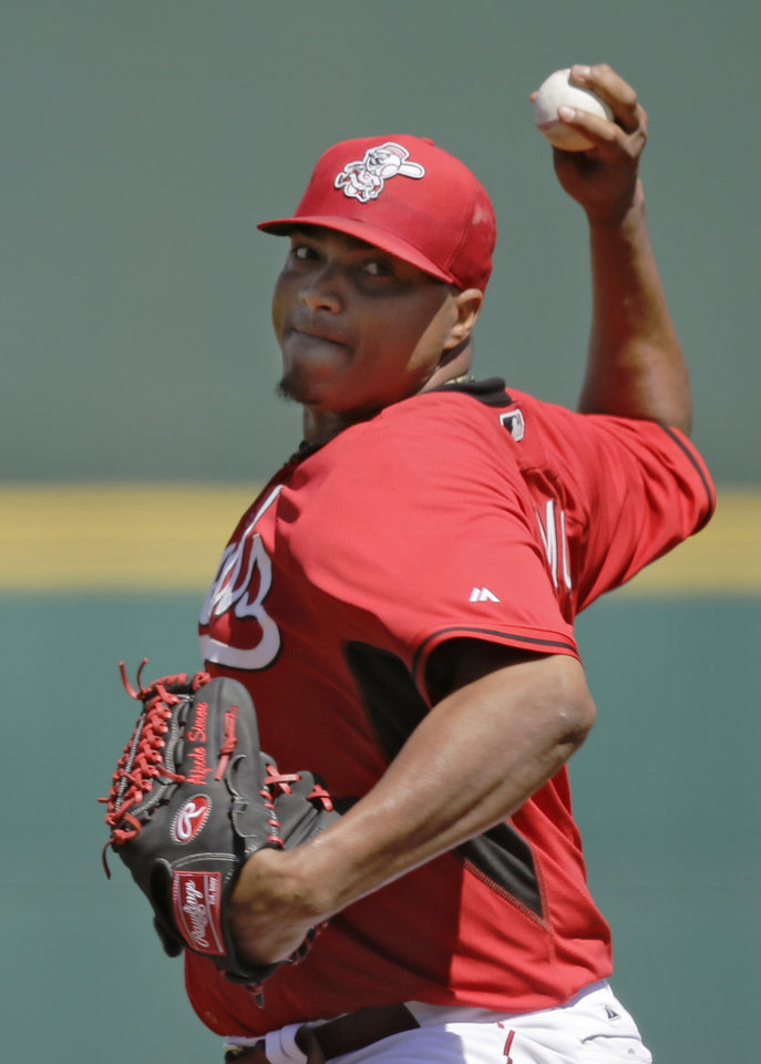 Photo - Cincinnati Reds pitcher Alfredo Simon delivers against the Cleveland Indians in the first inning of a spring exhibition baseball game Monday, March 24, 2014, in Goodyear, Ariz. (AP Photo/Mark Duncan)