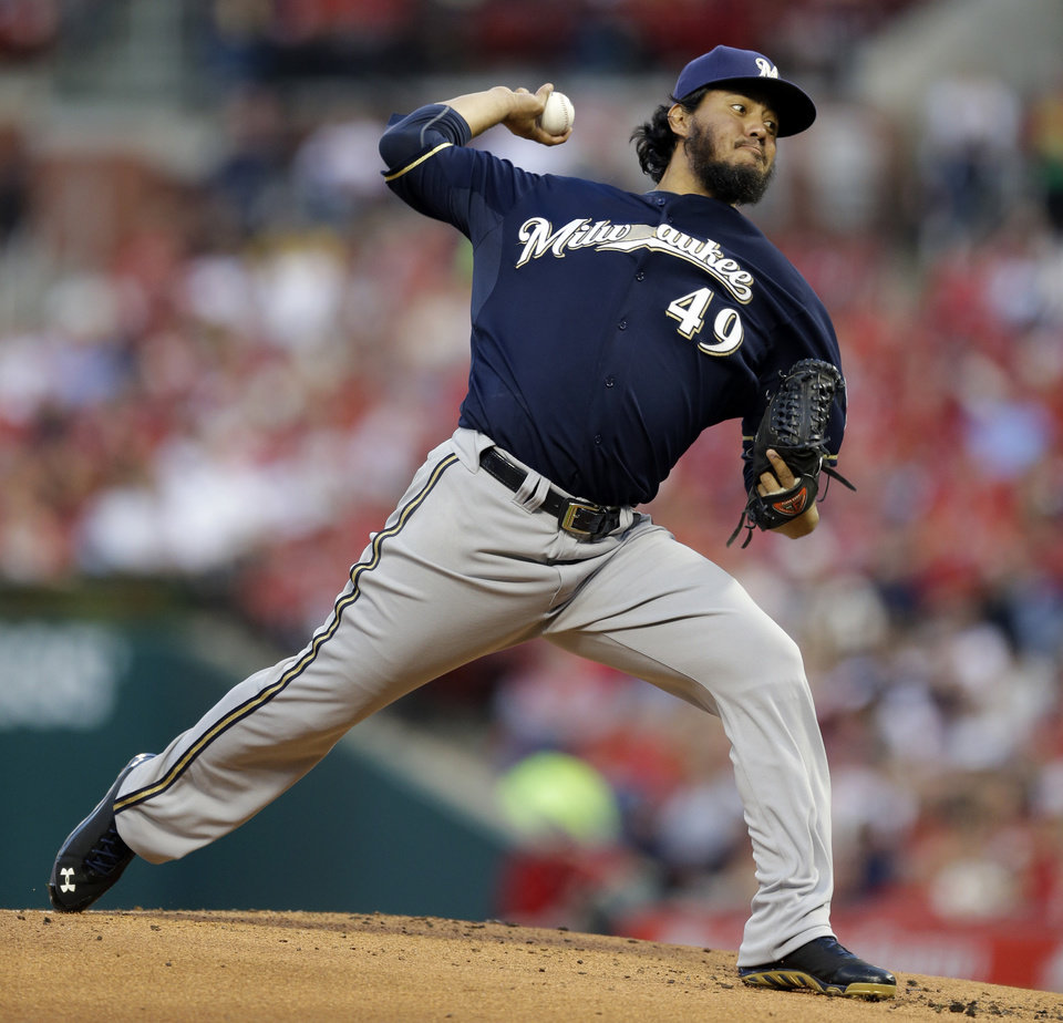 Photo - Milwaukee Brewers starting pitcher Yovani Gallardo throws during the first inning of a baseball game against the St. Louis Cardinals on Monday, April 28, 2014, in St. Louis. (AP Photo/Jeff Roberson)