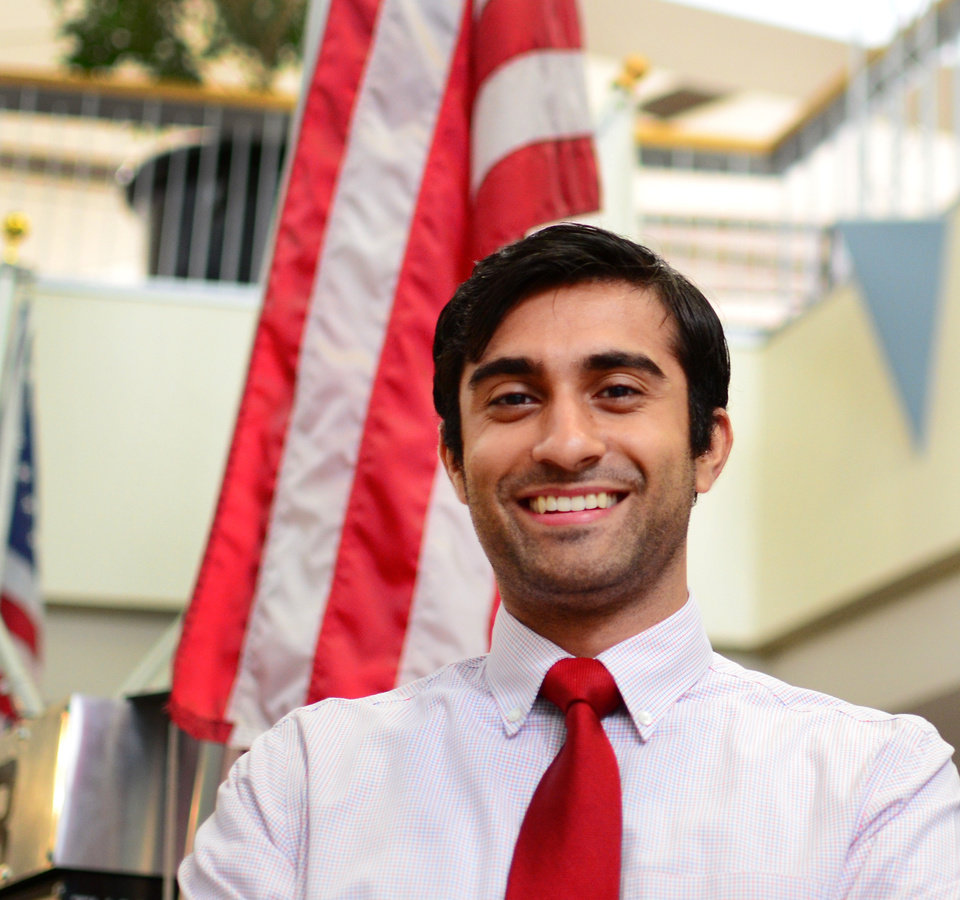 Photo -  Akash Patel, 23, is one step away from citizenship after a nearly two decade journey through the naturalization process. Photo by Josh Wallace