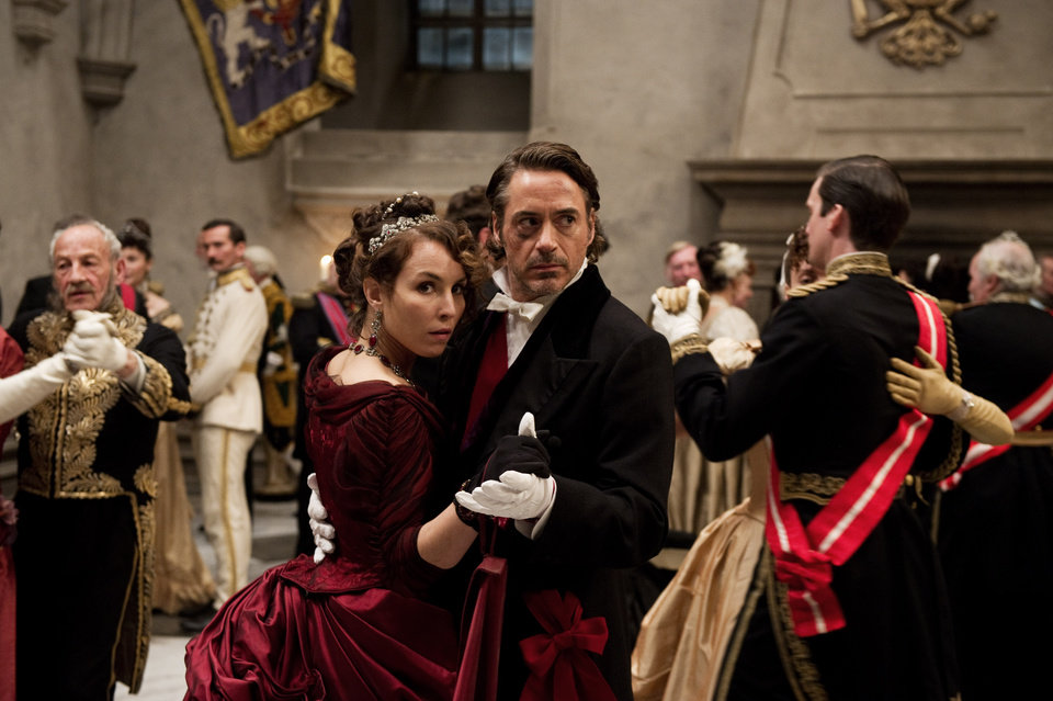 "In this film image released by Warner Bros. Pictures, Noomi Rapace, left, and Robert Downey Jr. are shown in a scene from ""Sherlock Holmes: A Game of Shadows."" (AP Photo/Warner Bros. Pictures)  ORG XMIT: NYET214"