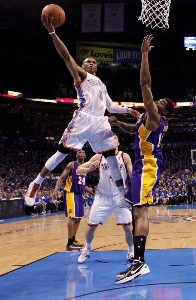 Photo - Oklahoma City's Russell Westbrook (0) goes past Los Angeles' Andrew Bynum (17) during Game 5 in the second round of the NBA playoffs between the Oklahoma City Thunder and the L.A. Lakers at Chesapeake Energy Arena in Oklahoma City, Monday, May 21, 2012. Photo by Bryan Terry, The Oklahoman