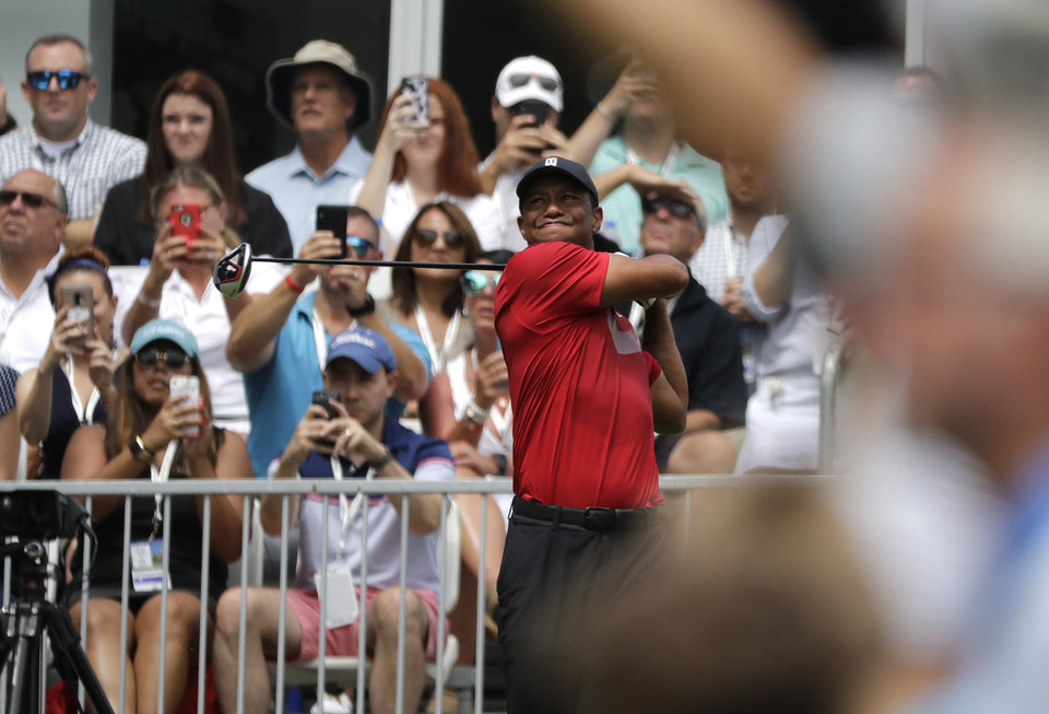 Photo -  Tiger Woods watches his tee shot on the 14th hole during the final round of the BMW Championship golf tournament at Medinah Country Club, Sunday, Aug. 18, 2019, in Medinah, Ill. (AP Photo/Nam Y. Huh)
