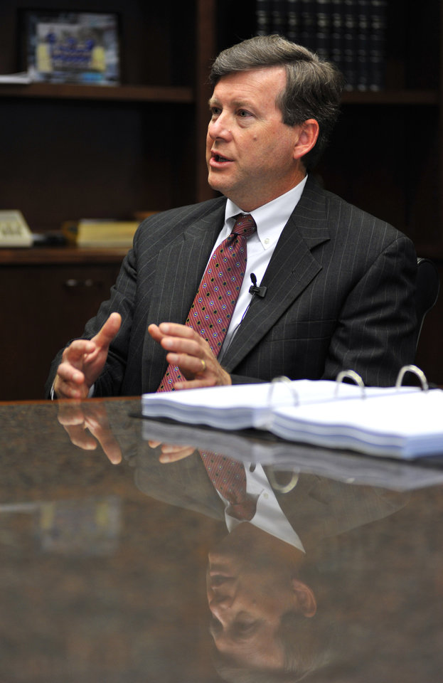 Photo - In this Wednesday, March 20, 2013 photo, Jacksonville, Fla., attorney Kelly Mathis speaks during an interview at his attorney's office in Ponte Vedra Beach, Fla. Mathis, has been identified by authorities as the ringleader of the Allied Veterans of the World Internet gambling operation. Fresh off a nearly $300 million racketeering case involving a veterans' charity that benefited from simulated gambling at Internet cafes, Florida regulators will investigate a children's cancer group connected to a similar operation that is four times bigger. (AP Photo/Rick Wilson)