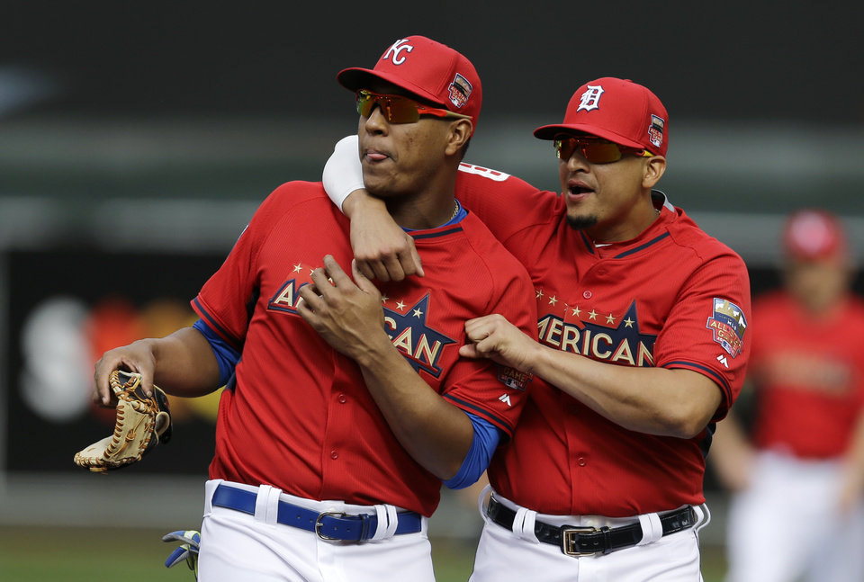 Photo - American League catcher Salvador Perez, of the Kansas City Royals, left, talks with Victor Martinez, of the Detroit Tigers, during batting practice for the MLB All-Star baseball game, Monday, July 14, 2014, in Minneapolis. (AP Photo/Jeff Roberson)