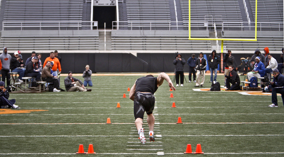 Photo - Dan Bailey takes off for his 40 yard run for NFL scouts during the NFL pro day at Oklahoma State University on Wednesday, March 9, 2011, in Stillwater, Okla.  Photo by Chris Landsberger, The Oklahoman