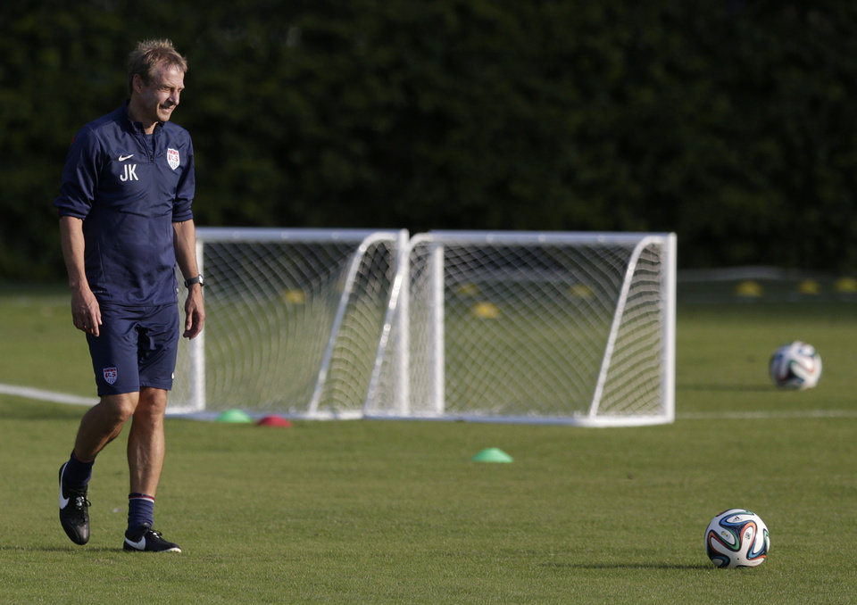 Photo - United States' head coach Jurgen Klinsmann walks a practice field during a training session in Sao Paulo, Brazil, Monday, June 23, 2014. The United States will play Germany in group G of the 2014 soccer World Cup on June 26 in Recife, Brazil. (AP Photo/Julio Cortez)