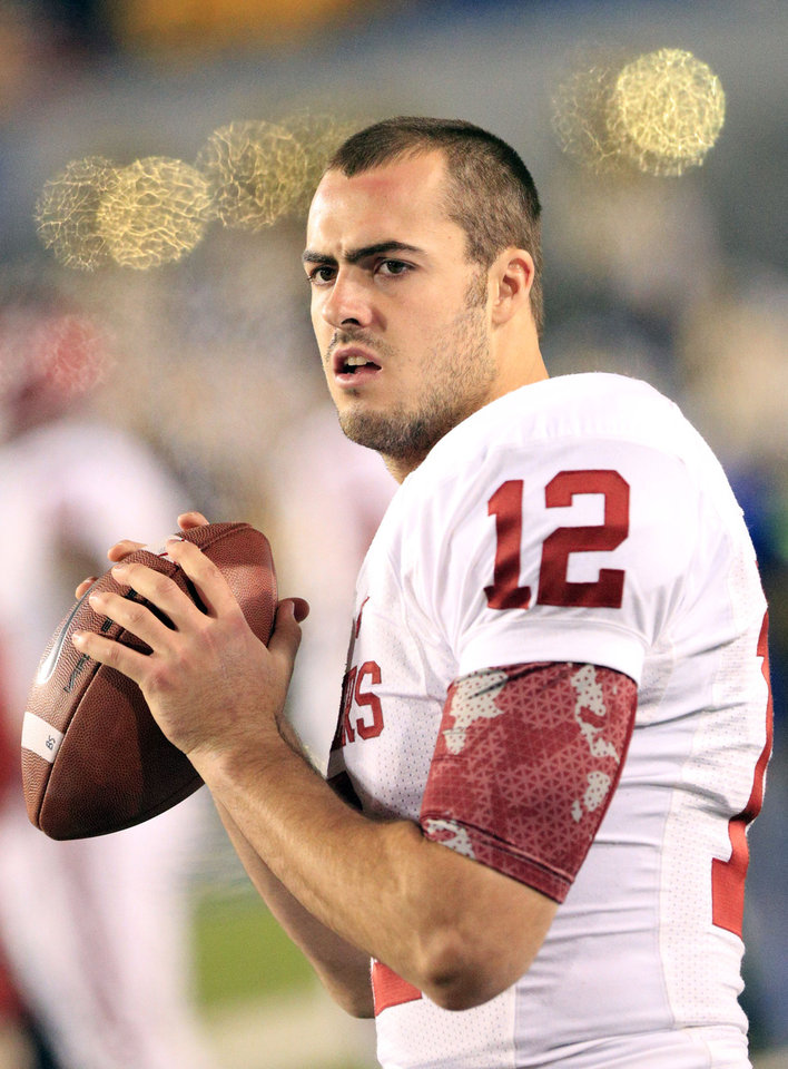 Photo -   Oklahoma quarterback Landry Jones warms up after half time during their NCAA college football game against Oklahoma in Morgantown, W.Va., on Saturday, Nov. 17, 2012. Oklahoma won 50-49. (AP Photo/Christopher Jackson)