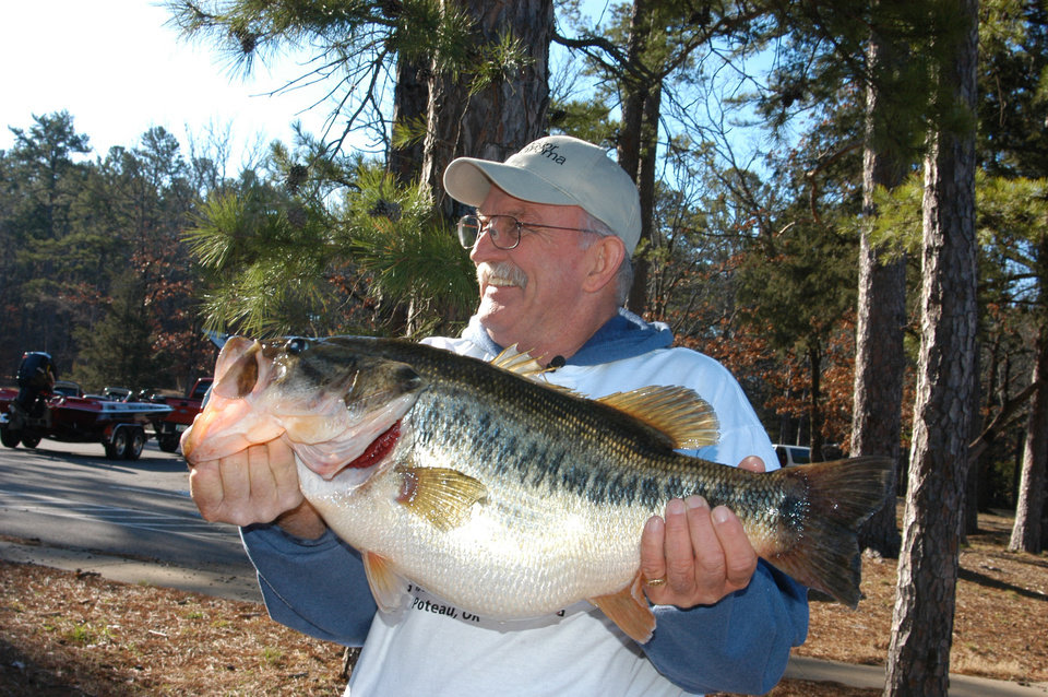 Photo - Dale Miller of Panama holds the new state record largemouth bass caught from Cedar Lake. It's the second consecutive year Cedar Lake has produced a state record bass. PHOTO PROVIDED