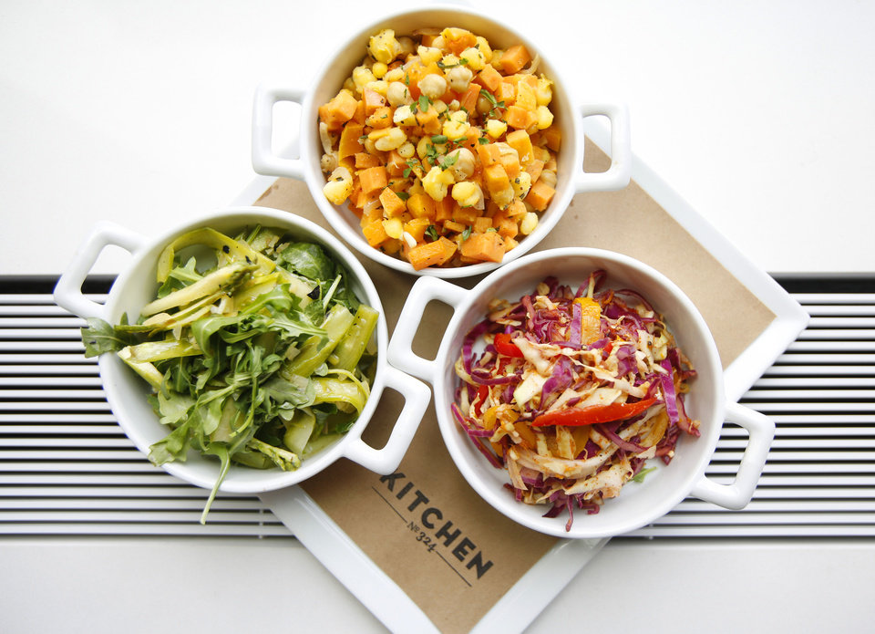 Photo - A vegetable plate at Kitchen 324, including Fall Succotash Scarlet Quinoa with Apples and Squash, and Shaved Asparagus and Arugula with Preserved Lemon Vinaigrette.  Steve Gooch - The Oklahoman