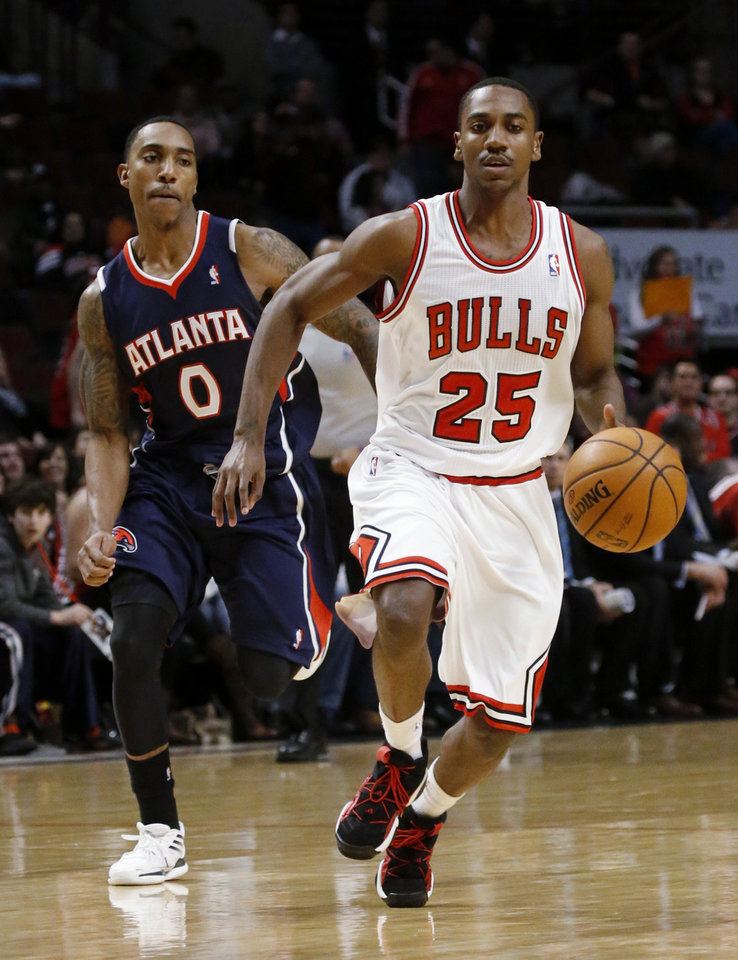 Chicago Bulls guard Marquis Teague (25) drives past Atlanta Hawks guard Jeff Teague, his brother, during the second half of an NBA basketball game Monday, Jan. 14, 2013, in Chicago. The Bulls won 97-58. (AP Photo/Charles Rex Arbogast)