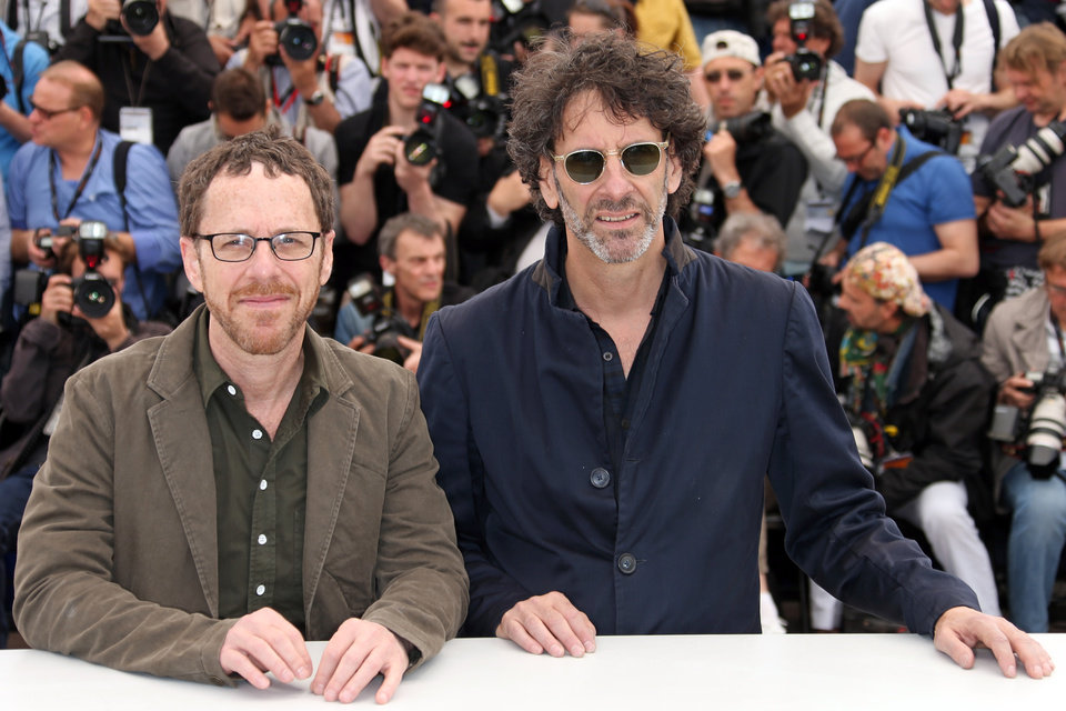 Photo - Directors Ethan Coen, left, and Joel Coen pose for photographers during a photo call for the film Inside Llewyn Davis at the 66th international film festival, in Cannes, southern France, Sunday, May 19, 2013. (Photo by Joel Ryan/Invision/AP)