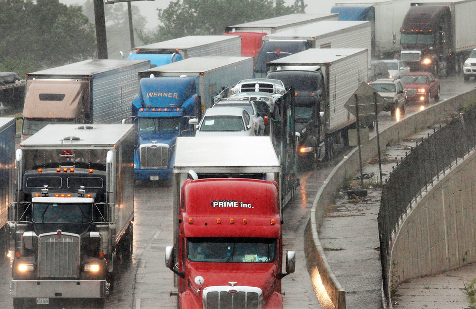 Photo - Cars and trucks are stopped Monday in eastbound lanes of I-44 near the Belle Isle Bridge. Torrential rain caused flooding in Oklahoma City.  Photo by by Jim Beckel, The Oklahoman