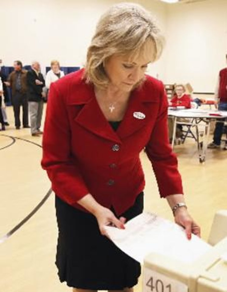 Photo - Oklahoma Governor-Elect Mary Fallin votes today. Photo by David McDaniel
