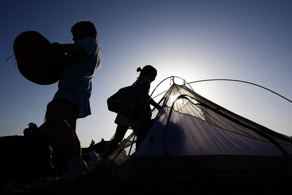 Anna Hall, 8, left, and Sarah McLain, 8, load their tent during a campout at St. Mary\'s Episcopal School in Edmond Thursday, June 26, 2008. BY DOUG HOKE, THE OKLAHOMAN