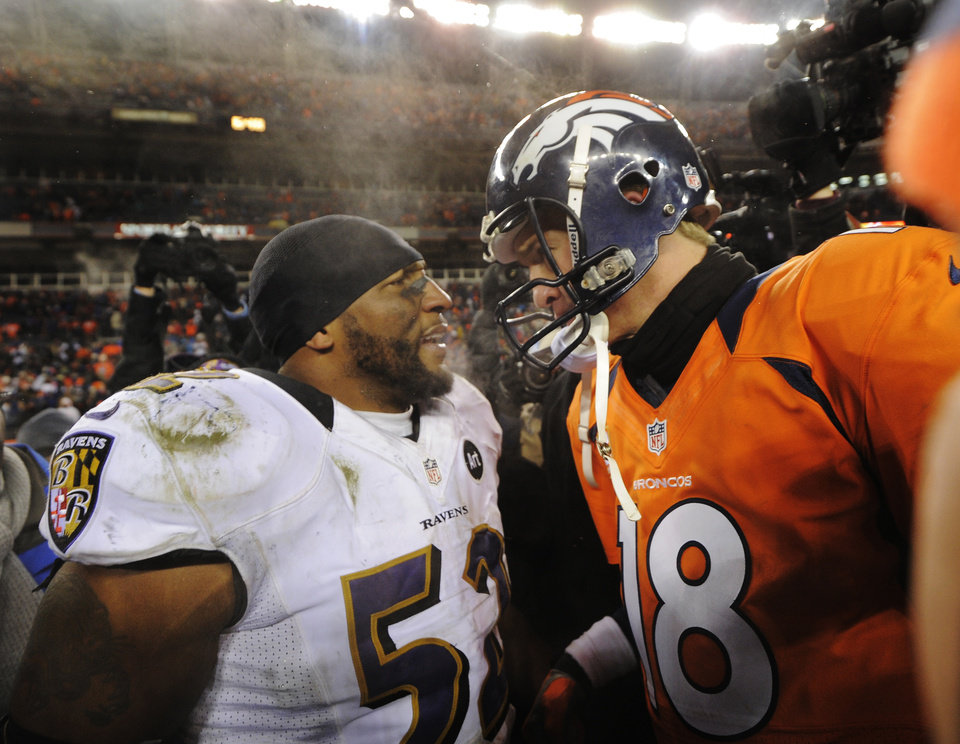 Photo - Baltimore Ravens inside linebacker Ray Lewis talks with Denver Broncos quarterback Peyton Manning (18) after the Ravens won 38-35 in overtime of an AFC divisional playoff NFL football game, Saturday, Jan. 12, 2013, in Denver. (AP Photo/Jack Dempsey)