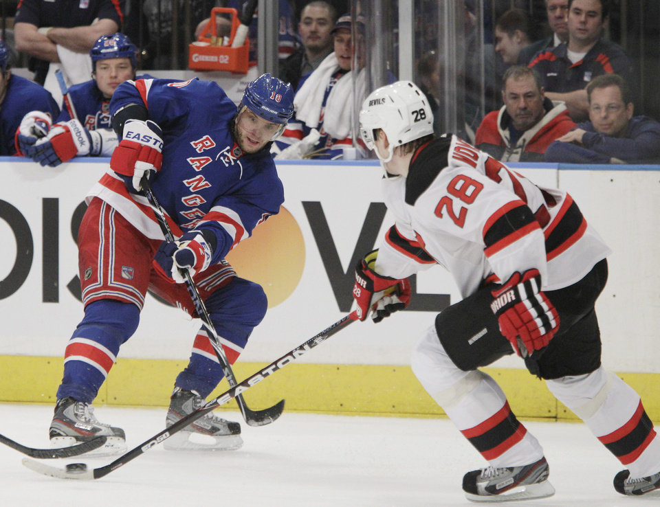Photo -   New York Rangers right wing Marian Gaborik (10) reacts after a pass that wound up in control of New Jersey Devils defenseman Anton Volchenkov (28) in the second period of their NHL hockey game at Madison Square Garden in New York, Monday, Feb. 27, 2012. (AP Photo/Kathy Willens)