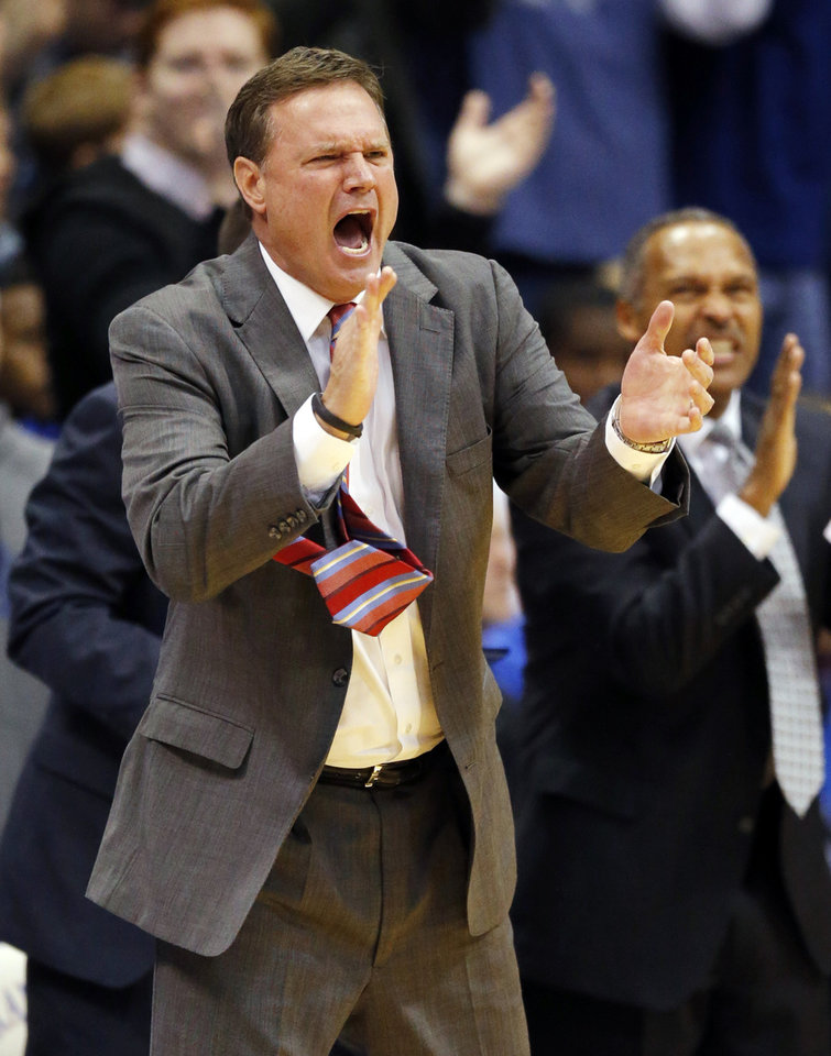 Photo - Kansas head coach Bill Self cheers his on his team's defense during the first half of an NCAA college basketball game against Kansas State in Lawrence, Kan., Saturday, Jan. 11, 2014. (AP Photo/Orlin Wagner)