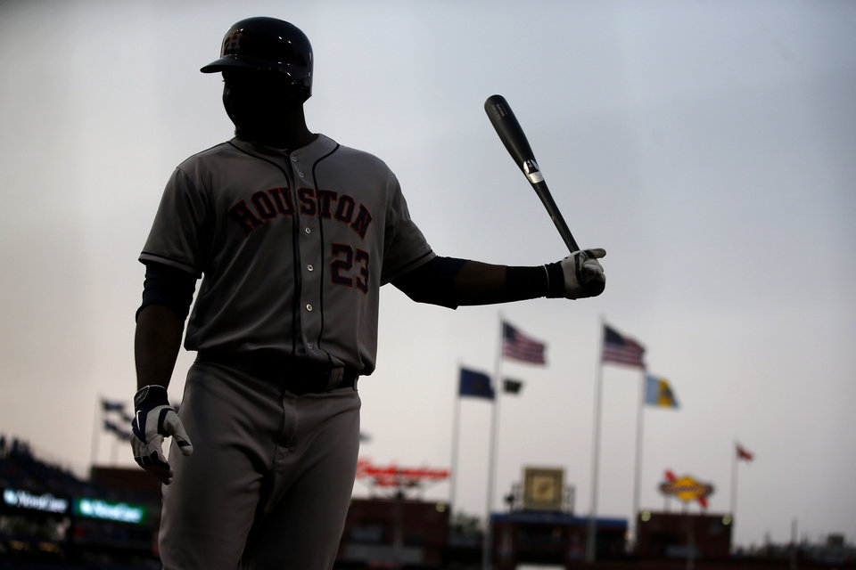 Photo - Houston Astros' Chris Carter warms up before batting during the first inning of an interleague baseball game against the Philadelphia Phillies, Thursday, Aug. 7, 2014, in Philadelphia. (AP Photo/Matt Slocum)