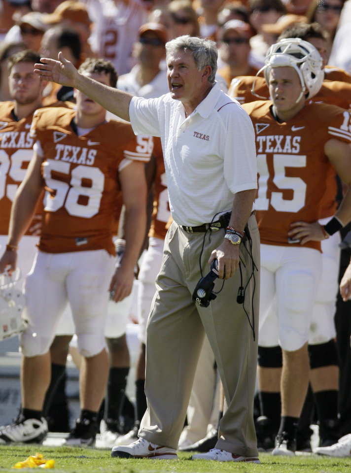Photo - University of Texas head coach Mack Brown shouts at officials following a penalty against his team during the first half of an NCAA college football game against Oklahoma, Saturday, Oct. 17, 2009, in Dallas. (AP Photo/Tony Gutierrez) ORG XMIT: TXTG115
