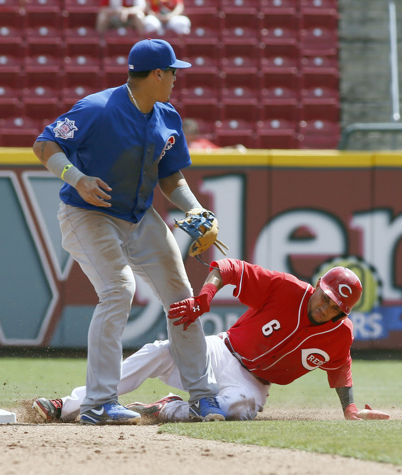 Photo - Cincinnati Reds' Billy Hamilton, right, is safe at second after an error by Chicago Cubs second baseman Javier Baez, left, in the sixth inning of a baseball game, Thursday, Aug. 28, 2014, in Cincinnati. The Reds won 7-2. (AP Photo/David Kohl)