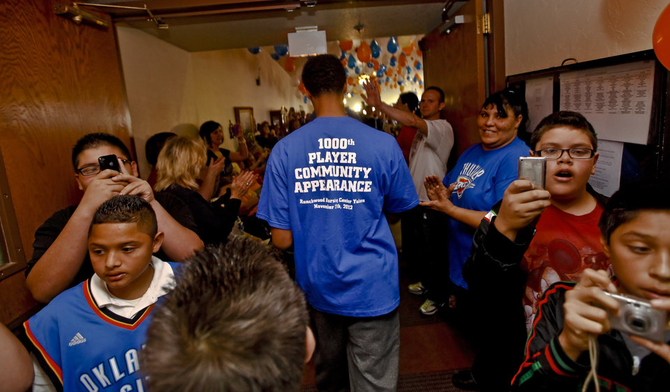 Jeremy Lamb is greeted by fans during the Oklahoma City Thunder's 1000th community appearance at Ranchwood Nursing Home on Tuesday, Nov. 27, 2012, in Yukon, Okla.   Photo by Chris Landsberger, The Oklahoman