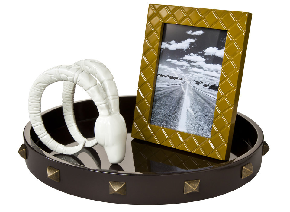 The Nate Berkus Collection for Target inlcudes this ram\'s head, frame and tray.