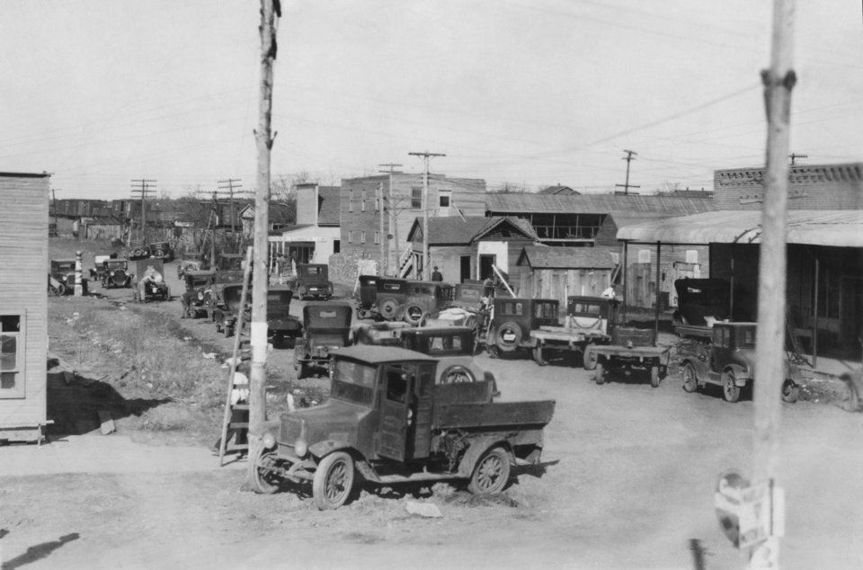 "STREET SCENES:  ""This was the beginning of 'Tough Town' or 'Bishop's alley,' a single street alongside the railway tracks in Seminole.  Later it strung out for a quarter-mile with hovels, cribs, dance halls, drinking joints, and gambling dives.  The tall building in the center later became ""The Palace."""
