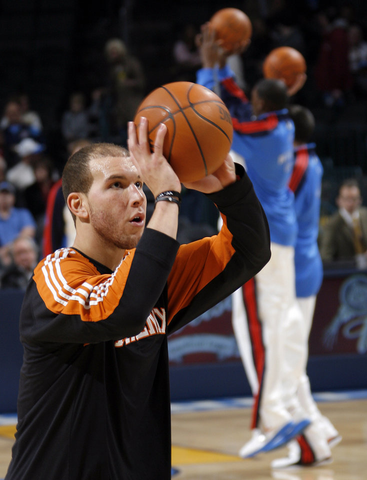Photo - Taylor Griffin (32) of Phoenix warms up during the NBA basketball game between the Phoenix Suns and the Oklahoma City Thunder at the Ford Center in Oklahoma City, Tuesday, Feb. 23, 2010. Photo by Nate Billings, The Oklahoman ORG XMIT: KOD