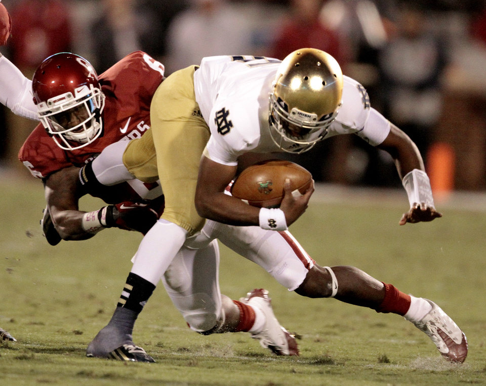 Oklahoma defensive back Demontre Hurst (6) brings down Notre Dame quarterback Everett Golson (5) during the first half of the college football game between the University of Oklahoma Sooners (OU) and the Fighting Irish of Notre Dame (ND) at Gaylord Family-Oklahoma Memorial Stadium in Norman, Okla., on Saturday, Oct. 27, 2012. Photo by Steve Sisney, The Oklahoman
