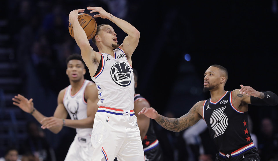Photo - Team Giannis' Stephen Curry, of the Milwaukee Bucks works against Team LeBron during the second half of an NBA All-Star basketball game, Sunday, Feb. 17, 2019, in Charlotte, N.C. The Team LeBron won 178-164. (AP Photo/Chuck Burton)