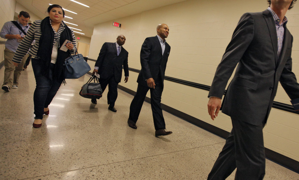 Photo - Newly signed Oklahoma City Thunder player Derek Fisher walks the hallway before the NBA basketball game between the Oklahoma City Thunder and the Los Angeles Clippers at Chesapeake Energy Arena on Wednesday, March 21, 2012 in Oklahoma City, Okla.  Photo by Chris Landsberger, The Oklahoman