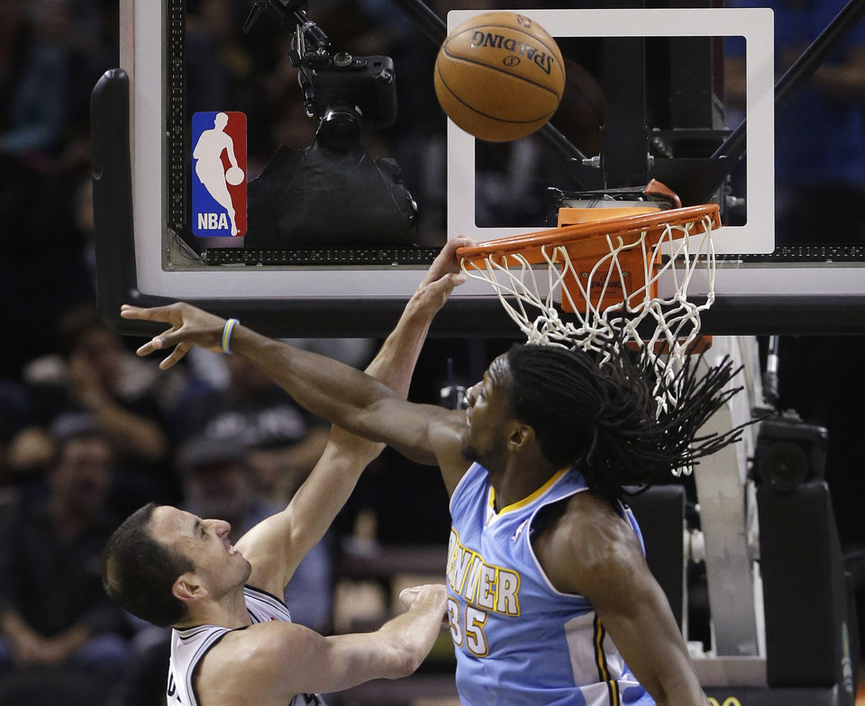 San Antonio Spurs' Manu Ginobili, left, of Argentina, goes to the basket as Denver Nuggets' Kenneth Faried (35) defends during the second half of an NBA basketball game, Wednesday, March 27, 2013, in San Antonio. San Antonio won 100-99. (AP Photo/Eric Gay)