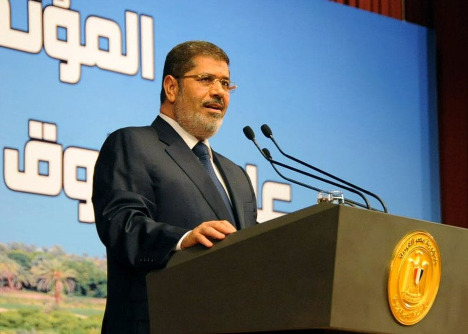 "In this Monday, June 10, 2013, photo released by the Egyptian Presidency, Egypt's President Mohammed Morsi speaks on Ethiopia's Nile dam project at a conference in Cairo. Morsi on Monday hardened his stance against Ethiopia and its construction of a Nile dam, warning that ""all options are open"" in dealing with the project that threatens to leave Egypt with a dangerous water shortage. (AP Photo/Egyptian Presidency)"