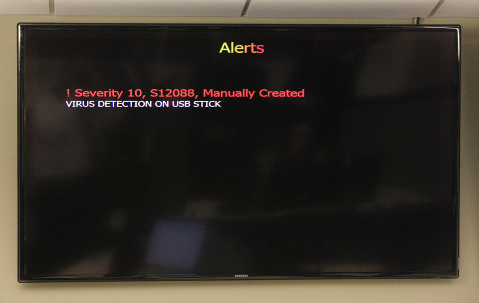 Photo - A test alert message about a virus detected on a state computer is displayed on a screen at State Cyber Command in the Security Operations Center room located at the State Data Center building in Oklahoma City. Photo by Paul B. Southerland, The Oklahoman  PAUL B. SOUTHERLAND