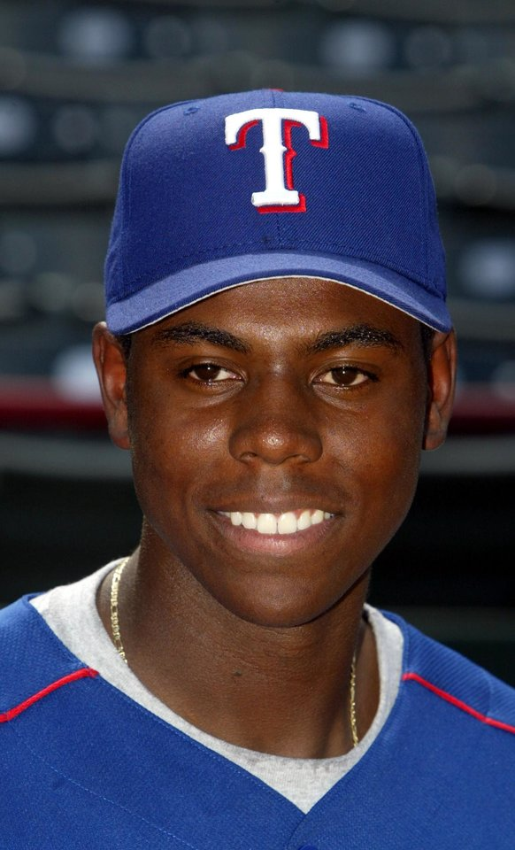 Photo - MAJOR LEAGUE BASEBALL: Texas Rangers first-round draft pick John Mayberry Jr. is shown at Ameriquest Field in Arlington, Texas, Tuesday, June 14, 2005. The 21-year-old junior from Stanford will begin his professional career with Spokane of the Class A Northwest League, moving from first base to the outfield. (AP Photo/The Dallas Morning News, Michael Ainsworth)